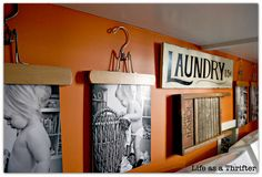 Use hangers to hang pictures in the Laundry room  SO CUTE!!!