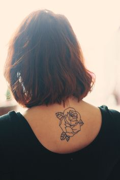 Rose tattoo...love the placement