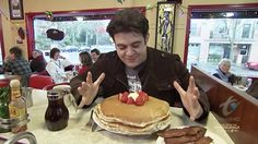 "Man V Food host Adam Richman grew up in Brooklyn, New York, completed his undergraduate degree in International Studies at Emory University in Atlanta, Georgia, and earned a master's degree from the Yale School of Drama. Although described as ""a bit on the husky side"", to maintain his health while indulging for the show, Richman exercises twice a day while he's on the road.When the schedule permits, he does not eat the day before a challenge and he tries to stay ""crazy hydrated"""