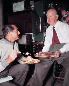 "Cary Grant and Alfred Hitchcock having a snack on the set of ""NORTH BY NORTHWEST"" (1959)."