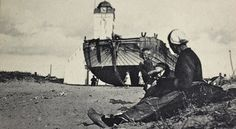 The Old Church in Katwijk aan Zee, before WWII. Here, one of the famous fishingsboats (called: Bomschuit) is waiting to be pulled back into the Northsea for another trip.