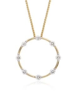 Grace your spring look with the elegance of this diamond circle pendant framed in 18k yellow gold.
