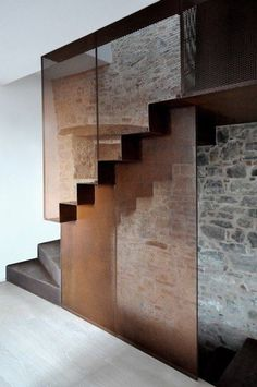 A beautiful staircase created with copper mesh, glass, and concrete.:
