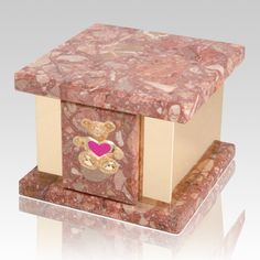 The Infinita Pernice Teddy Pink Heart Marble Cremation Urn is crafted from breccia pernice agglomerate marble and has a square base. A peaceful last resting place for your little Angel.   Bottom opening threaded plug.