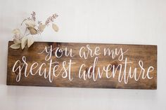 Purchase this you are my greatest adventure sign as a decoration for your wedding, home, or as an engagement photo prop. The sign is cut, sanded,