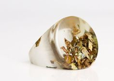 water clear eco resin circular ring featuring variegated metallic leaf flakes - size 5.5