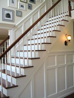 My husband did my kitchen walls like these are done and I just love them, now I am working on him redoing the stair case to match this and I will be so happy. He is so gifted I just have to get him in the right mood to work on our house. What a beautiful staircase and love how the heighth allows for all the pictures on the wall. Just about perfect look to me. J. Poppen
