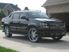Chevy Avalanche, tinted with rims.