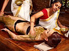 Woman having Ayurvedic treatment. body masking