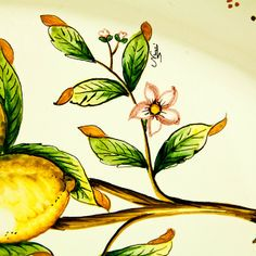 Beautiful ceramic oval platter with handles hand painted with lemons, leaves and branches. Click on the image to learn more about the platter.