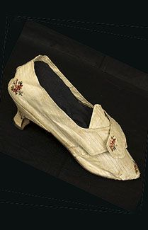 Silk/damask shoes, c.1780. The uppers are fashioned from beige silk damask woven with a monochromatic pattern of narrow stripes and from bouquets of small flowers. Great care was taken to make sure that flowers were placed on each toe. The shoes are lined with matching linen. The delicate heel, pointed toes, and peaked throat are all style features of the late 18th century