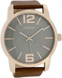 OOZOO Horloge Timepieces Collection 50 mm C6713. Stoer vormgegeven OOZOO horloge met rosekleurige kast en cognackleurige horlogeband. Het horloge heeft een doorsnede van 50 mm, heeft een grijze wijzerplaat met rosekleurige index, wijzers en is spatwaterdicht. De cognackleurigelederen horlogeband heeft een gespsluiting. Trendy, stoer en sportief model welke zowel door dames als heren gedragen kan worden.