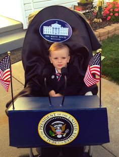 President costume. Foam board podium attached to stroller with zip ties, spray painted curlers (microphone), flags, and printed out seals.