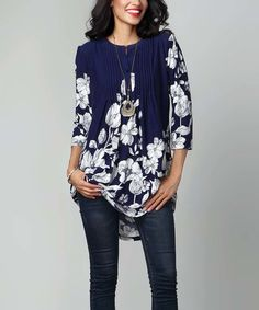 This Navy & White Floral Notch Neck Pin Tuck Tunic by Reborn Collection is…