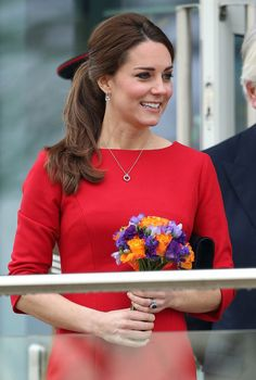 Pin for Later: Kate Middleton's Lucky Charm Stole the Spotlight This St. Patrick's Day Kate Middleton Style The duchess smiled brighter than her bouquet of flowers, her outfit complete with regal silver jewellery.