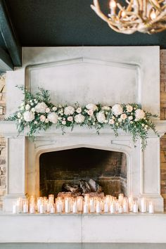 White Flowers and Greenery Fireplace Floral Design - Modern Design Wedding Fireplace Decorations, Wedding Mantle, Indoor Wedding Ceremonies, Wedding Ceremony, Our Wedding, Wedding Ideas, Candles In Fireplace, Fireplace Mantel, Fireplaces