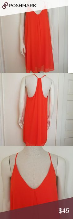 Gianni Bini Sleeveless Tent Dress This is such a great dress for summer! The putter layer is chiffon and it does have a lining. The material is very light and breezy. It is a beautiful vibrant orange color. The photos make it look almost neon, its not quite that bright. It has fully adjustable straps, size s although it seems like it could also fit a medium. Measurements  Length 26.5 inches Bust 18.5 inches Gianni Bini Dresses Midi