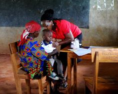 Our Community Health Nurse Winjoy attends to a child at one of our mother-child health clinics #publichealth #Kenya