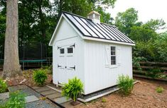 Shed with dark grey wood siding and white doors. Description from pinterest.com. I searched for this on bing.com/images