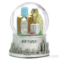 DetroitSnow Globe  OurDetroit Snow Globe captures the spirit ofMichigan in a fun size. Featuring theRenaissance Centers,Detroit Marriott, OneDetroit Center, Penobscot Building,and various buil