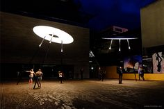 """Five """"GuddeVol"""" luminaires (Luxembourgish for """"good flight""""), with a diameter of more than 4 meters and a height of 5 meters, illuminate the """"Place des Hauts-Fourneaux"""". In cooperation with the light artist Ingo Maurer."""