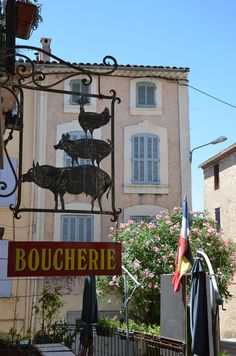 Boucherie sign with lovely shuttered building in background