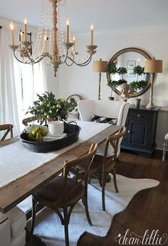 I love the height these lamps from HomeGoods add to the sideboard and the texture that the shades add to this simple black and white dining room. The wood tones throughout the room help add warmth to the space and balance out the elegance of the chandelier. (sponsored pin) #Diningroom