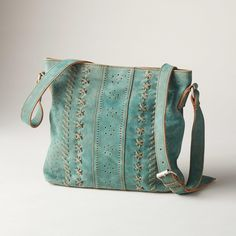 """AUSTEN SUEDE BAG--Rife with artisan charm and handwrought details, this handcrafted, suede bag is perforated, stitched and interwoven with leather accents. Imported. Approx. 11-3/4""""W x 2""""D x 10-1/4""""H."""