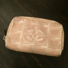 AUTHENTIC CC TRAVEL LINE RARE BEIGE ROSE 100%AUTHENTIC Rare beige rose cosmetic bag or pouch .. hold money lipstick and small items very easy ....RARE EDITION WITH ROSE THREAD ...in good used condition has 1 small spot the could be cleaned up nicely at a chanel day spa I just never had time to ....rose with rose thread has been discontinued here's your chance to own this beautiful piece ...feel free to ask questions and thank u for looking. .happy poshing..... CHANEL Bags Cosmetic Bags…