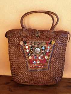 Woven Italian leather bag, embellished with banjara antique textiles and kuchi decors. #ethnicstyle #vintagebags #Italian leather #intrecciato #graffititamtam #pompon #kuchi #madeinitaly