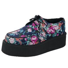 T.U.K. Shoes Mondo Hi Sole Navy Floral Creepers. The Floral Print Mondo Hi soled traditional brothel creeper Round toe with a Hi 4cm ribbed sole A Hawaiian inspired floral design running throughout the shoe Traditional stainless steel D-ring's Manmade material, making these shoes vegan friendly