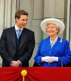A beaming Queen on the balcony with her grandson and heir Prince William