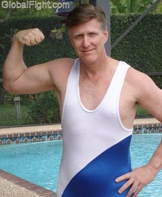 a hot hubby posing wrestling singlet flexing biceps daddy poolside