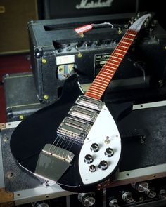 Often affiliated with The Beatles, the Rickenbacker 325 V64 Miami will give you the Liverpool tone. Full details and pricing at elderly.com. Beatles Guitar, The Beatles, Electric Guitars, Liverpool, Miami, Music Instruments, Musical Instruments