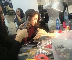 Arianna Cortese and Carina Sary in Sartorial LAB...Final touches for OPIUM-Haute Couture Collection
