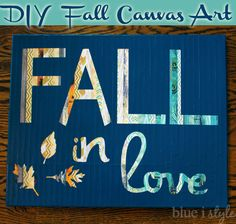 Fall in Love easy canvas art using scrapbook paper and spray paint {from Blue i Style}