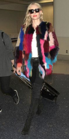 Colorful fur with a white tee and black denim.