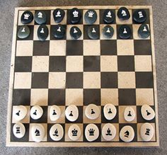 Rock Chess Set... I am painting a chess board onto a stump and making these pieces for a game for our new patio!!!
