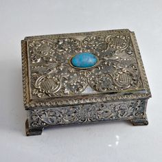 antique jewelry box...check for silver hallmarks.  I had one exactly like this when I was a preteen (think mid-60's).  The turquoise was fake and it was stamped steel from India.  Loved the heck out of it until the hinge broke :(.