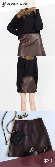 """Zara Faux Leather A-line Skirt Size Small Excellent condition, almost new. Looks real and has pockets! Gorgeous burgandy/brown color. Super cute with almost any shoe (booties, Heels, clogs, flats, Sneakers). It's too big for me now. 18"""" length, 13.5"""" waist. Non smoking, pet free home. Thanks for shopping my closet! Zara Skirts"""