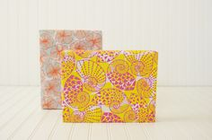 Aloha attire approved. These pink swirly shells and bright orange flowers make for tropical gift wrapture.
