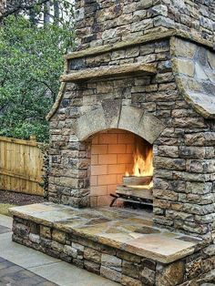 I'm wrapped in a soft, wooly sweater. The fall air is cool and crisp. With a nice Cab in hand, and family and friends gathered round, this fireplace exudes a comforting warmth.
