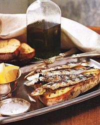 Fresh Sardines on Grilled Bread, the Portuguese way with olive oil and coarse salt, these sardines are delectable.