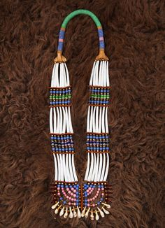 Appropriation of indigenous design may be an ongoing issue, but these six talents are reclaiming their heritage through distinctive collections. Native American Artwork, Native American Regalia, Native American Beadwork, Seashell Jewelry, Beaded Jewelry, Beaded Necklaces, Indian Beadwork, Dance Accessories, Beadwork Designs