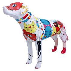 Guia Folha - Exposições - Artistas pintam esculturas de cachorro que irão a leilão por no mínimo R$ 1 mil - 11/05/2013
