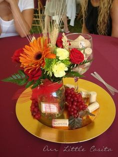 wine theme centerpieces without the gold plate and different flowers