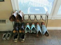 Boot rack made from used horse shoes!  Looks like a quilt rack too.