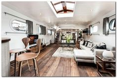 The Dutch barge, built in 1959 is transformed in a luxury floating penthouse. It is moored at Oyster Pier, a new development in Battersea, South Lond