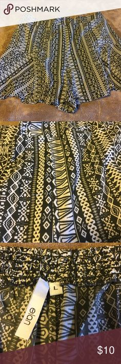 Print flare shorts Fun! Fun! Fun! These are perfect, light shorts for summer. These are a size large flare shorts that is an olive green and cream. Like new. Wore once Shorts
