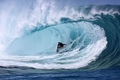 "A surfer rides a wave during the shooting of a remake of the 1991 classic ""Point Break"" on September 11, 2014 in the Hava'e pass in Teahupoo, on the French Polynesian island of Tahiti. The American action thriller film directed by Ericson Core, starring Edgar Ramirez, Luke Bracey, Teresa Palmer and Ray Winstone, is a remake of the 1991 film then directed by Kathryn Bigelow. (Photo by Gregory Boissy/AFP Photo)"